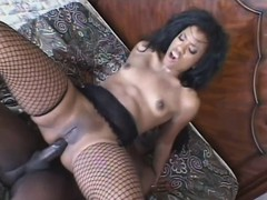 That babe sticks his huge black rod in her fiery ass and bounces on it until she's pleased