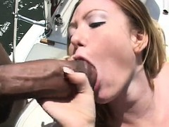Out on a boat, a sultry white babe has two black studs fucking her tight wet crack