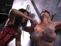 Ebony Dominatrix Abusing Large Boobed Blond