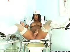 Fearsome nurse Manuela checks her open pussy with a mirror